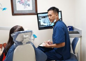 Dr Chiu consulting with a patient
